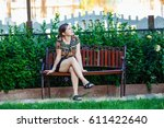 pretty young woman sitting on a ...   Shutterstock . vector #611422640