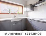 Small photo of Light kitchen with flowers and steely canopy