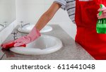 cleaning bathroom sink with... | Shutterstock . vector #611441048