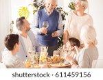 happy  multigenerational family ... | Shutterstock . vector #611459156