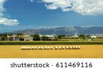 summer field with hay bales... | Shutterstock . vector #611469116