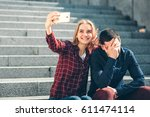 woman makes selfie  but her... | Shutterstock . vector #611474114