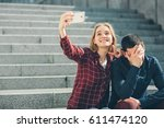 woman makes selfie  but her... | Shutterstock . vector #611474120