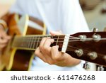 close up man's hands playing... | Shutterstock . vector #611476268