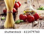 spaghetti tomatoes basil olive... | Shutterstock . vector #611479760