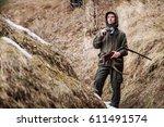 male hunter with binoculars... | Shutterstock . vector #611491574