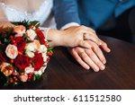 closeup  hands of bride and... | Shutterstock . vector #611512580