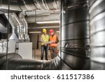 workers making final touches to ... | Shutterstock . vector #611517386