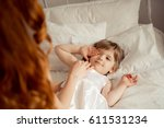 mom wakes her sleeping daughter ... | Shutterstock . vector #611531234