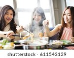 happy young women group  eating ... | Shutterstock . vector #611543129