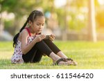 little asian girl using... | Shutterstock . vector #611546420