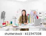 a young fashion designer... | Shutterstock . vector #611547338