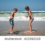 brother and sister playing with ... | Shutterstock . vector #611562110