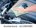 wipe cleaning the car engine... | Shutterstock . vector #611584580