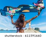 woman holding floating fabric... | Shutterstock . vector #611591660