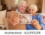 portrait of a senior couple... | Shutterstock . vector #611592158