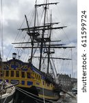Small photo of Saint-Malo, France–March 28, 2017: Etoile du Roy is a three-masted sixth-rate frigate. She is a replica of a corsair frigate and can be visited all year in Saint-Malo, France. Vertical stern view