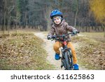 child on a bicycle in the... | Shutterstock . vector #611625863