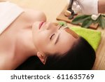 spa. beautiful young woman... | Shutterstock . vector #611635769