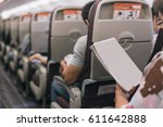 passenger reading a blank page... | Shutterstock . vector #611642888