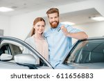 happy couple holding car key... | Shutterstock . vector #611656883