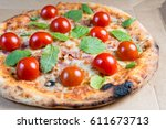 tasty pizza on a the table | Shutterstock . vector #611673713