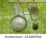 kitchen tools on a grey tile... | Shutterstock . vector #611685566