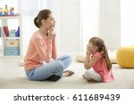 cute little girl at speech... | Shutterstock . vector #611689439