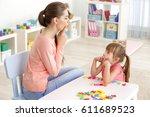 cute little girl at speech...   Shutterstock . vector #611689523