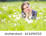 smiling young woman speaking on ... | Shutterstock . vector #611696510