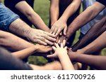 group of people holding hand... | Shutterstock . vector #611700926