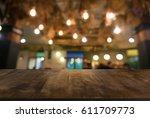 empty dark wooden table in... | Shutterstock . vector #611709773