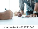 close up of young architects... | Shutterstock . vector #611711060
