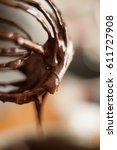 warm chocolate ganache dripping ... | Shutterstock . vector #611727908