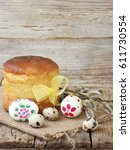 Small photo of Easter composition of sweet bread, paska and eggs on wooden background. Orthodox kulich. Holidays breakfast concept with space for text.