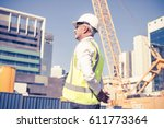 engineer man in helmet and... | Shutterstock . vector #611773364