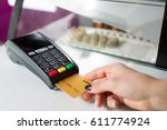 pos terminal in the shop. | Shutterstock . vector #611774924