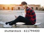 skateboard girl using listening ... | Shutterstock . vector #611794400