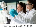 two young female geneticists... | Shutterstock . vector #611819198