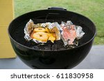 charcoal grill with salmon and... | Shutterstock . vector #611830958