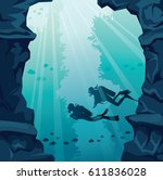 Silhouette Of Two Scuba Divers...