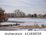 frozen pond surrounded by trees ... | Shutterstock . vector #611838539