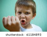 boy showing his fist. | Shutterstock . vector #61184893