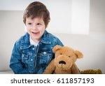 little boy sitting on the... | Shutterstock . vector #611857193