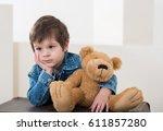 little boy sitting on the... | Shutterstock . vector #611857280