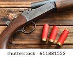 Shotgun And Shells On Wood.