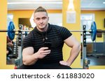 young handsome man using phone... | Shutterstock . vector #611883020