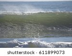 wave cresting with spray off | Shutterstock . vector #611899073