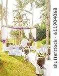 outdoor beach wedding setup in... | Shutterstock . vector #611904068