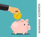 businessman hand putting a coin ... | Shutterstock .eps vector #611904524